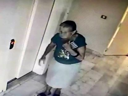 Security camera footage of the elderly woman in one of the apartments she stole from.