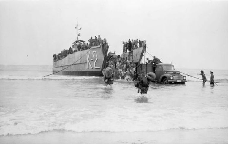 This image from 1958 shows a Spanish amphibious craft unloading supplies during the Ifni War.