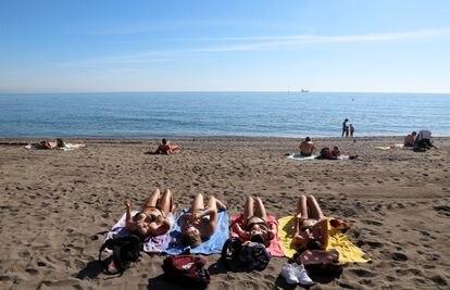 Sunbathers on Malagueta beach in Málaga on January 29.