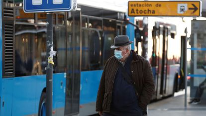 A man wears a mask outside Atocha train station in Madrid on Monday.