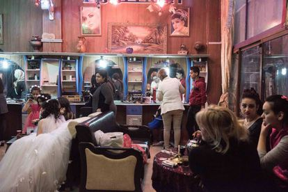 Brides preparing for their wedding at at the Alestora beauty salon in Homs.