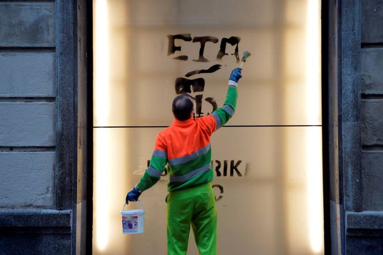 A worker cleans graffiti in support of Basque terror group ETA.