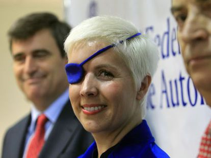Villota during a press conference after her operation.