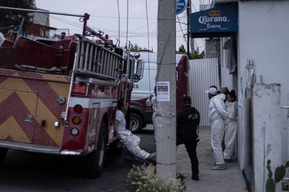Forensics experts outside the home of Andrés N in Atizapán.