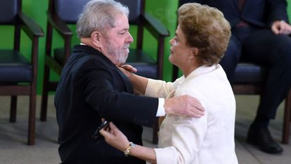 Lula embraces Rousseff at his swearing-in ceremony on Thursday.