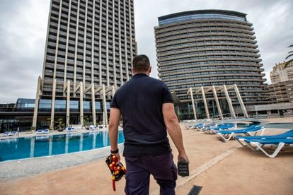 Benidorm's tourism sector is getting ready to reopen. Above, a maintenance worker at the Hotel Bali.