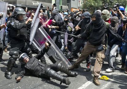 Demonstrators clash with riot police during a protest on September 1, 2013, in Mexico City.