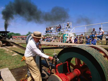 A man tests a steam engine at a festival in the US.