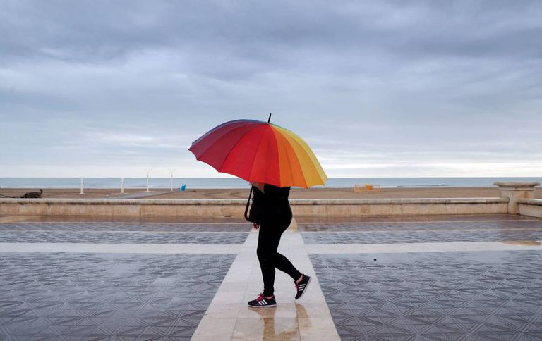 Rain falls in Malvarrosa beach in Valencia on Sunday.