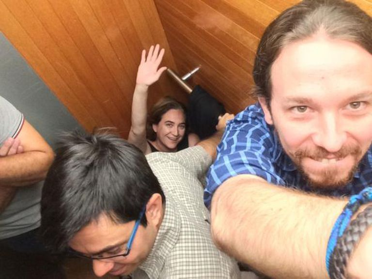 A photo posted on Twitter by Pablo Iglesias of himself stuck in the elevator, with Mayor Colau waving in the background.
