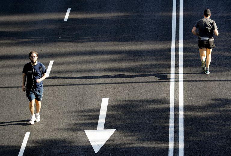 Joggers on the Paseo de la Castellana, in Madrid, on Sunday.
