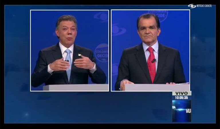 Santos (left) and Zuluaga during the televised debate.