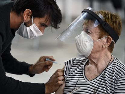 A woman receives the Covid-19 vaccine in Argentina.