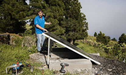 Marco Sánchez works on solar panels in El Hierro.
