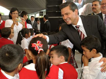 A photograph provided by the Mexican Presidency shows Enrique Peña Nieto greeting a group pf schoolchildren earlier this month.