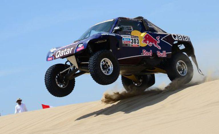 Spain's Carlos Sainz steers his Buggy during Stage 1 of the Dakar 2013.