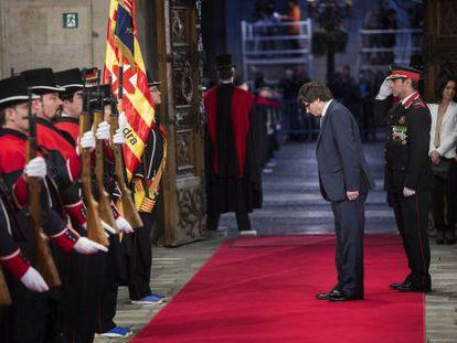 New Catalan premier Carles Puigdemont walks into the Palau de la Generalitat.