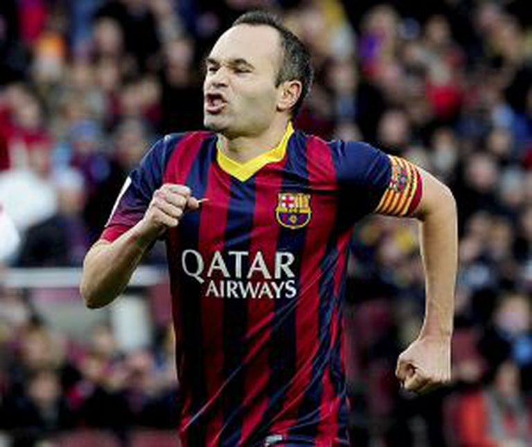 Barcelona's midfielder Andrés Iniesta celebrates after scoring during the Spanish league football match FC Barcelona vs Granada CF at the Camp Nou stadium in Barcelona on November 23, 2013.