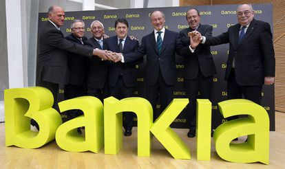 Caja Madrid Chairman Rodrigo Rato (center) in March 2011 with the chiefs of the six other savings banks which made up Bankia. Just over a year after it would be nationalized.