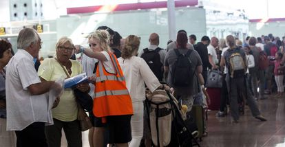 Staff at Barcelona airport direct passengers this week.