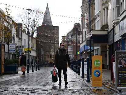 A woman walking down an empty street in Dover.