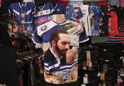 A jersey emblazoned with an image of Nayib Bukele is displayed for sale at a market in San Salvador.