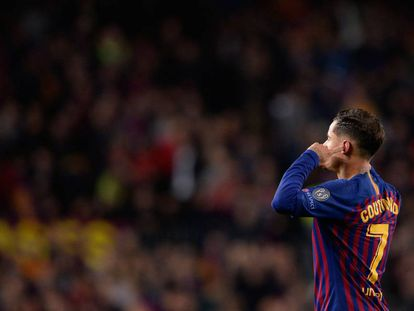 Coutinho plugs his ears and looks up at the Camp Nou terraces after scoring against United.