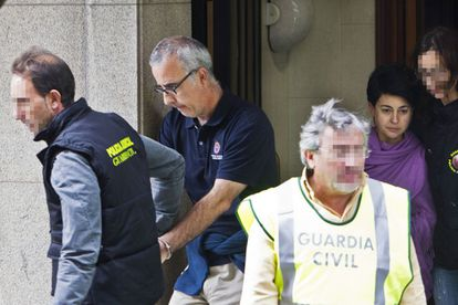 Alfonso Basterra and Rosario Porto during a police search of their home shortly after Asunta was found dead.