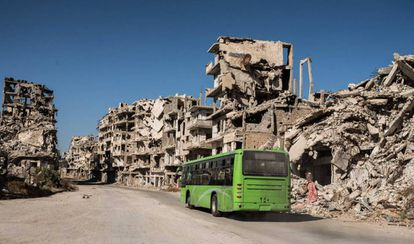 A public bus serves the families who have returned to the Khalidiya district of Homs.