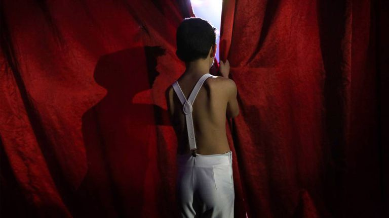 A child performer waits his turn to go into the ring at Gottani Circus.