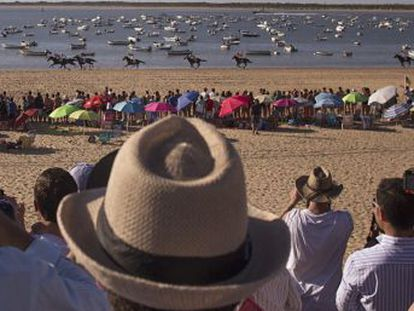 Glamor and poverty collide during horse racing carnival in southern Spanish town of Sanlúcar de Barrameda