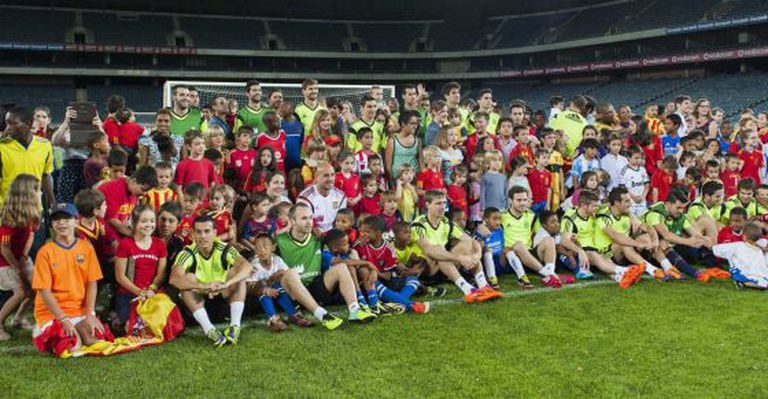 Spain's players pose with South African children in Johannesburg.