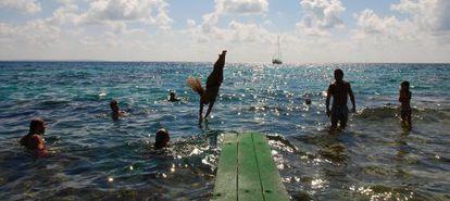 Bathers at the Sa Trinxa club on Las Salinas beach in Ibiza.