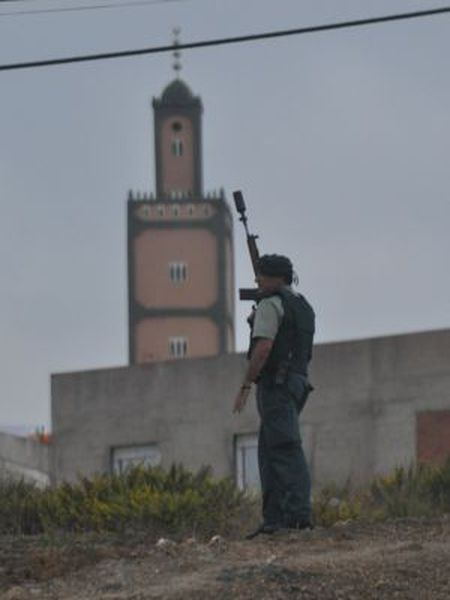 A Civil Guard patrols near the troubled El Príncipe neighborhood in Ceuta.