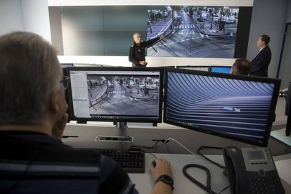The local chief of police in Marbella, Javier Martín (l), and the council's computer specialist, José Alonso, explain the new video surveillance system.
