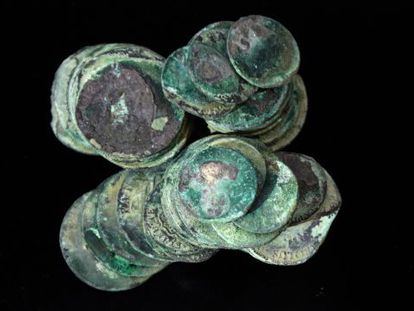 Silver coins that were found in the shipwreck of La Mercedes.