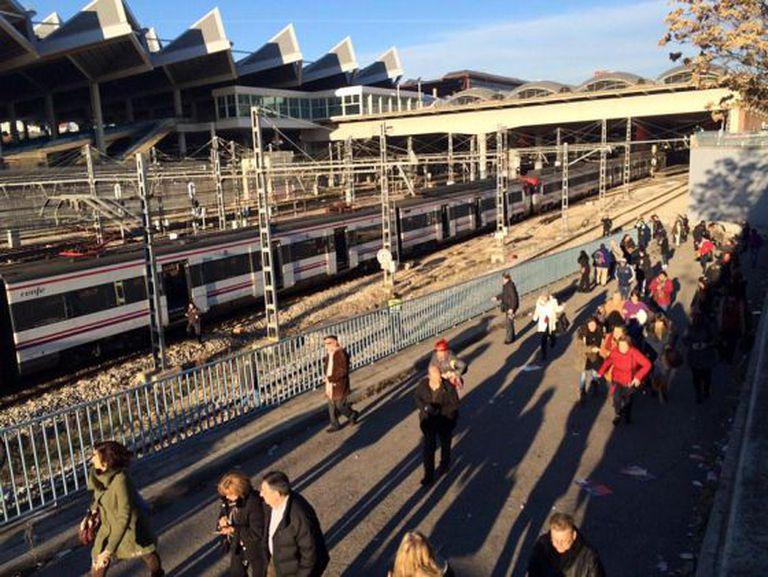 Passengers are evacuated outside Atocha station on Friday.