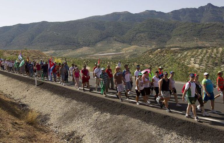 Laborers set off on their first of a series of marches in Andalusia to call attention to high unemployment in the region.