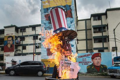A giant effigy of President Obama burns on a street in Caracas.