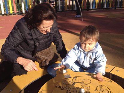Erundina Baamonde with her two-year-old grandson, Martín.