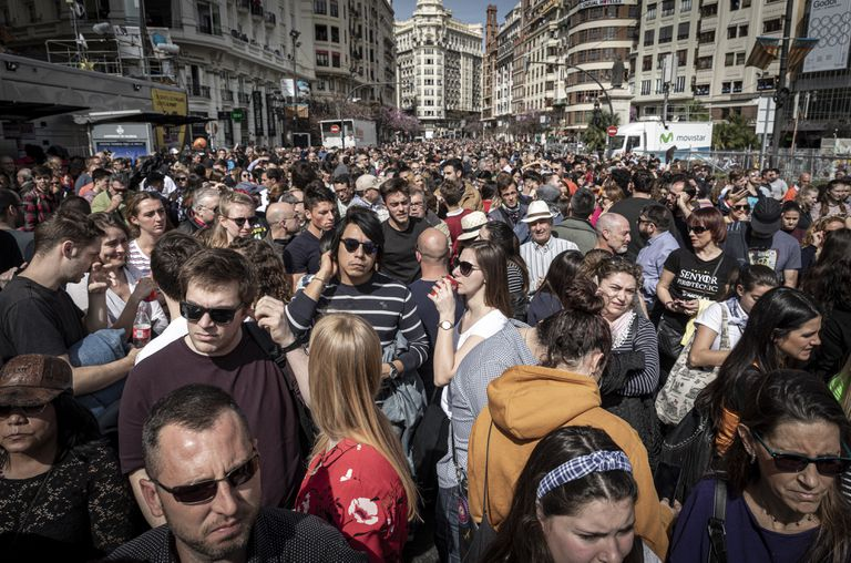 Crowds await the start of the 'mascletà' in the city of Valencia on Tuesday.