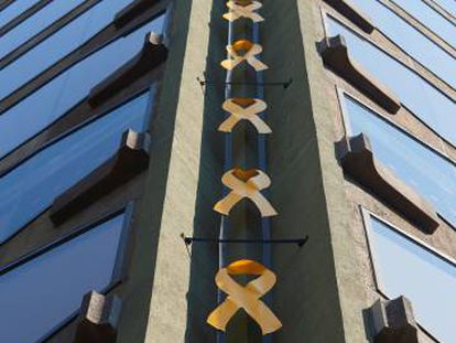 Yellow ribbons adorn a building in Barcelona.
