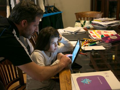 Spanish children taking online classes at home on March 11.