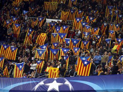 Soccer fans display the estelada at a recent match.