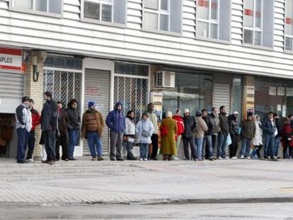 People line up outside an employment office.
