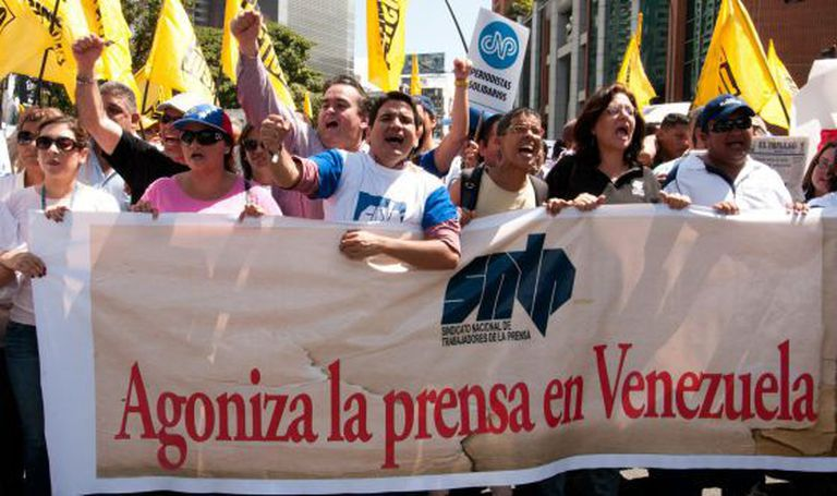 Journalists protest in Caracas on February 11.