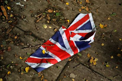 A soiled Union Jack on a London street the day after the Brexit vote.