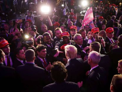 Donald Trump greets supporters following his election win.