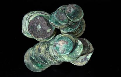 Fused silver and gold coins retrieved from the wreck of the Nuestra Señora de la Mercedes.
