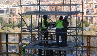 Construction workers at a site in Madrid.